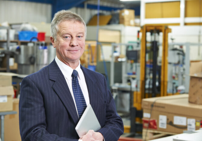 Portrait Of Factory Owner With Digital Tablet